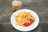 foto of green papaya salad  - som tam thai green papaya salad sticky rice in bamboo container - JPG