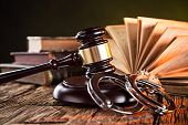 stock photo of law-books  - Wooden gavel and books on wooden table - JPG