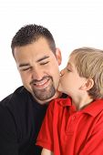 child kissing father isolated on white