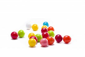 stock photo of gumballs  - Multicolored gumballs sitting in a white background - JPG