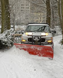 image of slippery-roads  - Truck with snowplow on road after snowstorm
