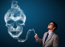 picture of tobacco smoke  - Handsome young man smoking dangerous cigarette with toxic skull smoke - JPG