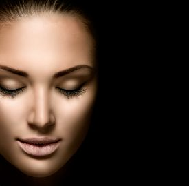 image of dark-skin  - Beauty woman face closeup isolated on black background - JPG