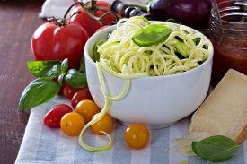 image of noodles  - Zucchini noodles in a bowl with fresh vegetables and cheese  - JPG