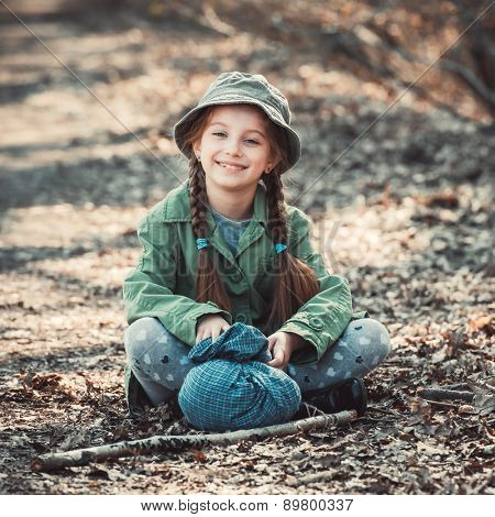 little girl playing in the woods, photo in vintage style