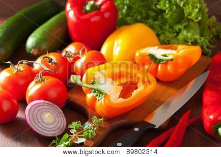 chopping healthy vegetables pepper tomato salad onion chili on rustic background