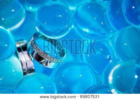 Wedding rings amid blue balls
