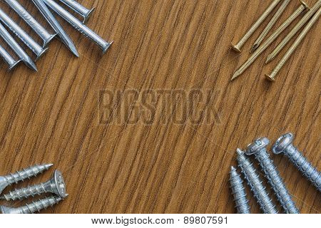 Nails And Screws On A Wooden Background With Copy Space