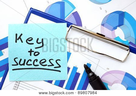 Paper with words Key To Success and graphs.