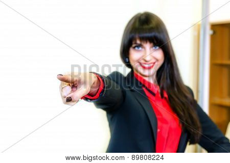 Smiling Business-woman Shows Finger Forward. Focus On A Finger