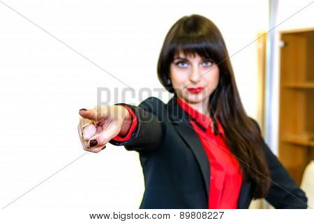 Serious Business-woman Shows A Finger Forward, Focus On A Finger