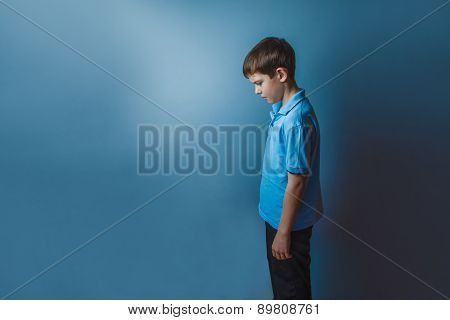 Boy teenager European appearance ten years standing sideways loo