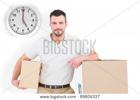 Delivery man with trolley of boxes against five o clock