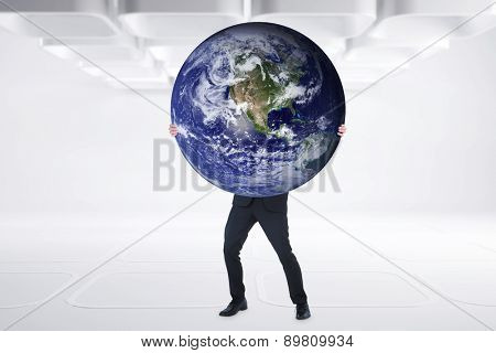 Businessman carrying the world against white abstract room