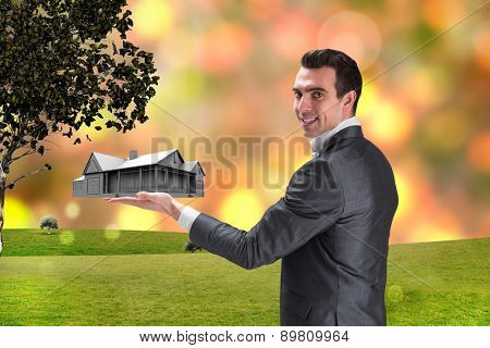 Businessman presenting with hand against glowing lights behind field