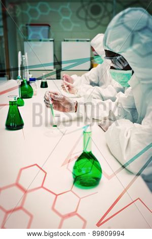 Science and medical graphic against chemists in protective suits working with green chemical
