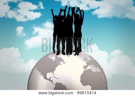 Silhouette of cheering people against blue sky
