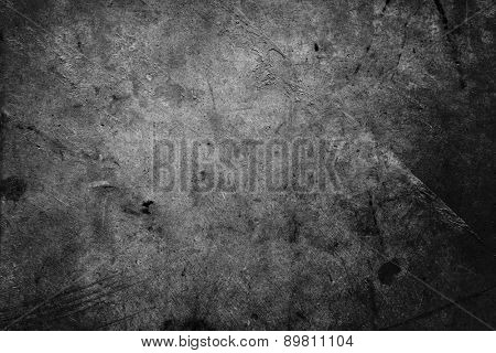 Dark grunge textured wall closeup
