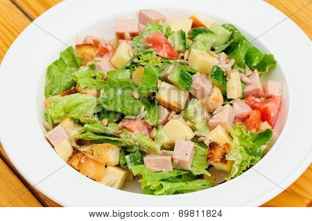 salad with cheese, ham fresh tomatoes, lettuce, sunflower seeds and crackers
