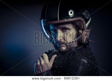 Freedom, biker with motorcycle helmet and black leather jacket, metal studs