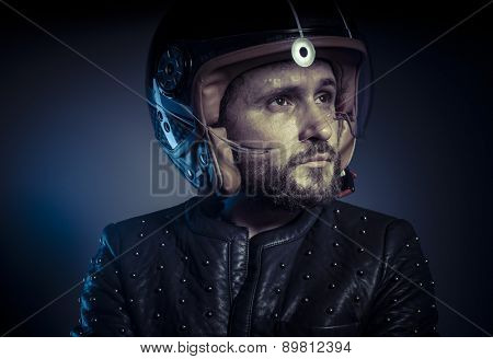 Racer, biker with motorcycle helmet and black leather jacket, metal studs