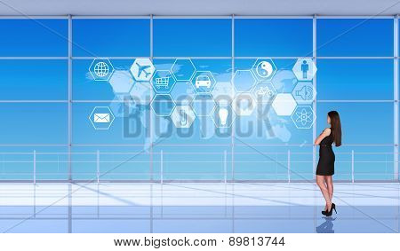 Businesslady half-turned in front of window