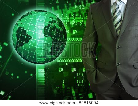 Businessman on abstract green background