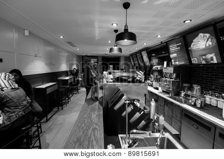 PARIS - SEPTEMBER 06: Starbucks cafe interior on September 06, 2014 in Paris, France. Paris, aka City of Love, is a popular travel destination and a major city in Europe