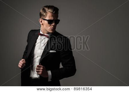 Confident sharp dressed man in black suit