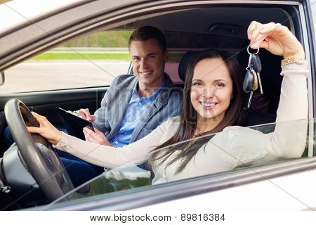 Happy driving student with a car keys
