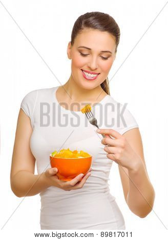 Happy young woman with fruit salad isolated