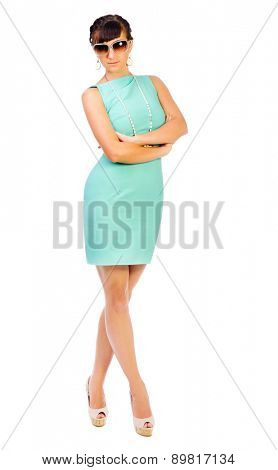 Glamorous girl in turquoise dress with sunglasses isolated