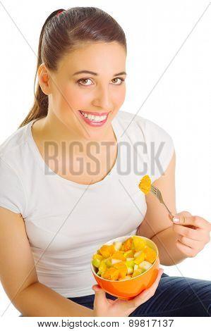 Young girl eat fruit salad isolated