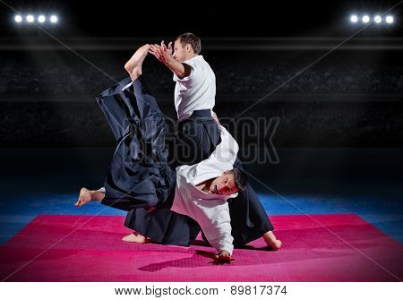 Fight between two aikido fighters at sport hall