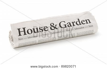 Rolled Newspaper With The Headline House And Garden