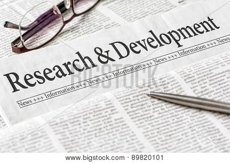 A Newspaper With The Headline Research And Development
