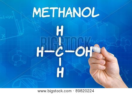 Hand With Pen Drawing The Chemical Formula Of Methanol