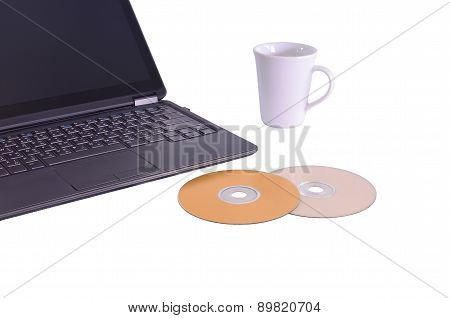Isolated Of Laptop Dvd And Glass