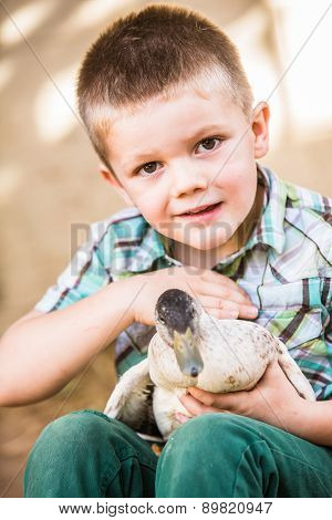 Happy Child Petting Duck