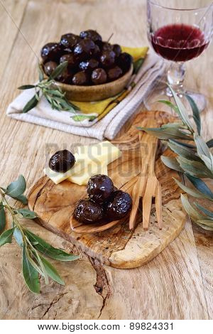 Marinated Olives, Slices Of Cheese And Wineglass