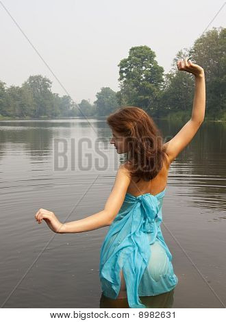 Girl Posing Against River