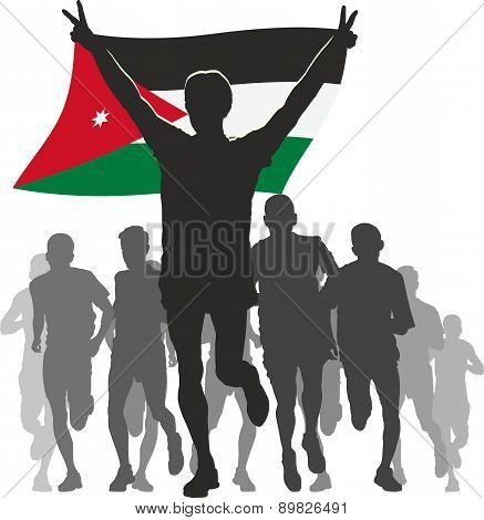 Athlete with the Jordan Emirates flag at the finish