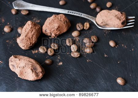 Chocolate Truffles In An Unusual Shape With Metal Cutlery