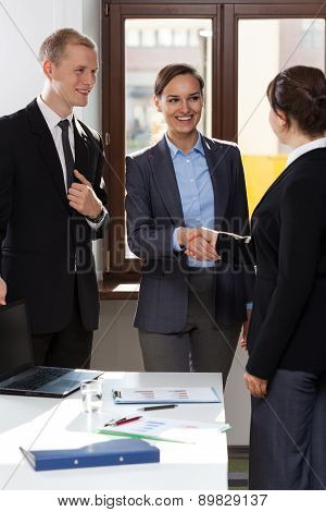 Business Co-workers Shaking Hands