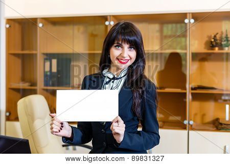 Happy Woman With Empty Card In Office