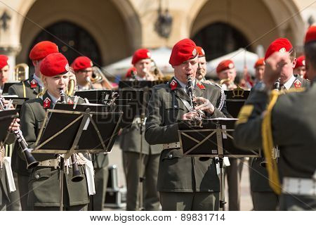 KRAKOW, POLAND - MAY 3, 2015: Military Band on main square of Krakow during annual Polish national and public holiday the Constitution Day. May 3, 1791 was adopted first Constitution of modern Europe.