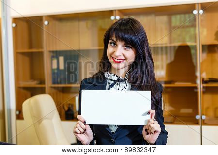 Beautiful Happy Woman With Empty Card In Office