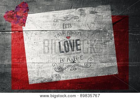 Valentines love letter against overhead of wooden planks