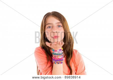 Loom rubber bands bracelets blond kid girl blowing hand on white background