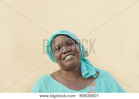 Afro woman wearing a traditional headscarf